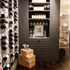 Contemporary Room With Wine Bottle Wall Art And Built In Shelving