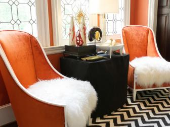 Orange Foyer With Upholstered Chairs and Chevron Area Rug
