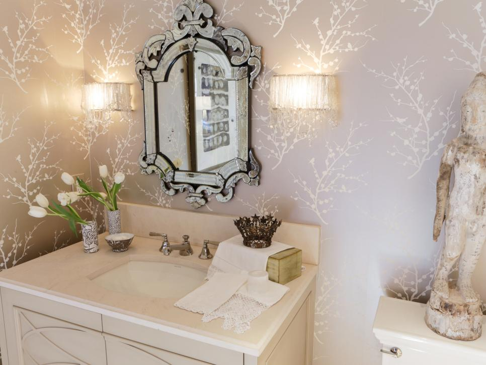 Beige Bathroom With Cream Vanity, Detailed Mirror and Wallpaper