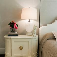 White Nightstand and Lamp With Elegant Tablescape Accessories
