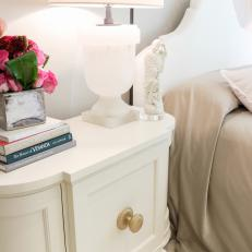Antique Cabinet Used as Nightstand in Tranquil Bedroom