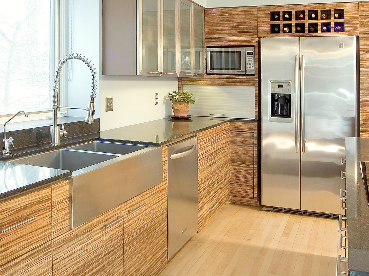 Contemporary Kitchen With Bamboo Cabinets And Stainless Steel Countertops