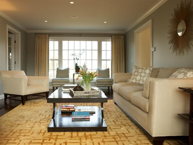Living Room With Beige Sofa, Area Rug, Beige Chair & Dark Coffee Table