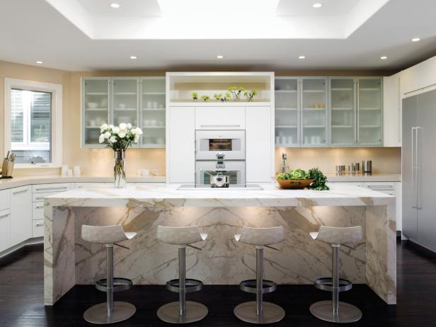 Attractive Contemporary White Kitchen With A Waterfall Style Calacatta Marble Island