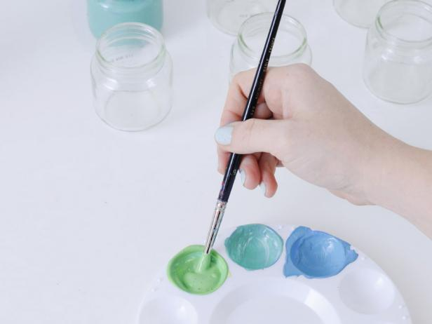 When painting the vases, mix the first section of paint until fully combined, then paint the inside of the largest jar. Repeat with the remaining two jars.