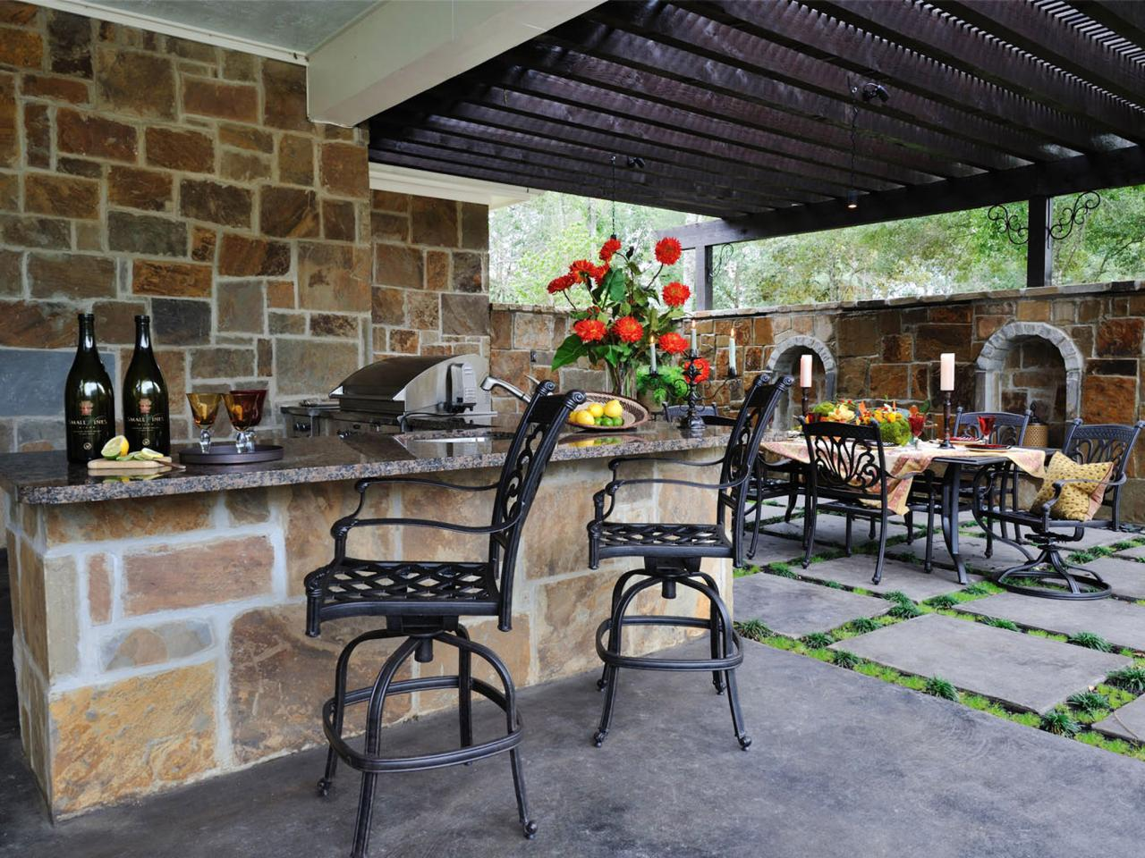 Building an Outdoor Kitchen: Pictures & Ideas From HGTV | HGTV on covered outdoor cooking, covered terrace ideas, covered outdoor fireplaces, covered grill ideas, covered deck with kitchen, covered outdoor chairs, covered hot tub ideas, covered pergola ideas, covered patio designs, covered bbq ideas, covered privacy fence ideas, covered outdoor architecture, covered outdoor kitchens and patios, covered outdoor living rooms, covered backyard ideas, covered balcony ideas, covered fireplace ideas, cool outdoor bar ideas, rustic outdoor ideas, covered walkway ideas,
