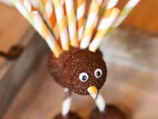 Foam balls, googly eyes, paint and colorful paper straws are all you need to help kids craft these cute turkey decorations for Thanksgiving.
