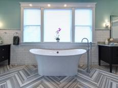 Designer Joni Spear went above and beyond in this ultra-chic bathroom remodel, resulting in a striking design that exudes both glamour and comfort.