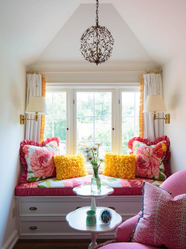 Sitting Nook With Pink Floral Pillows, Cushions and Metal Chandelier