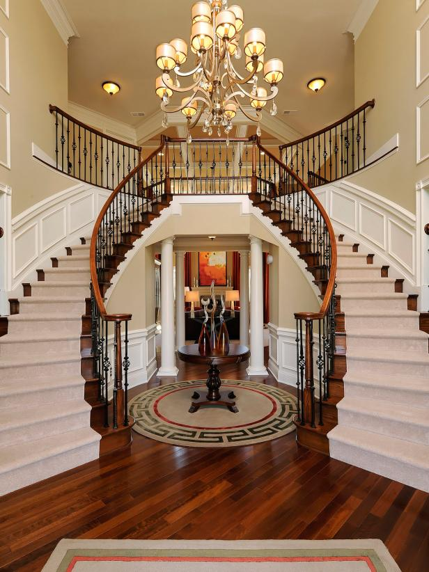 Double Staircases with Chandelier in Foyer