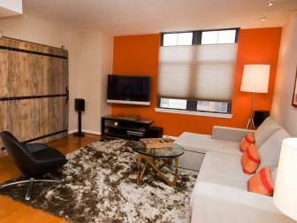 Orange Accent Wall Electrifies Contemporary Living Room