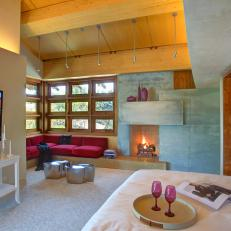 Contemporary Master Bedroom With Stone Fireplace