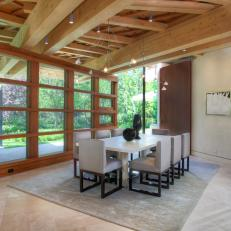 Contemporary, Rustic Dining Room With Exposed-Beam Ceiling