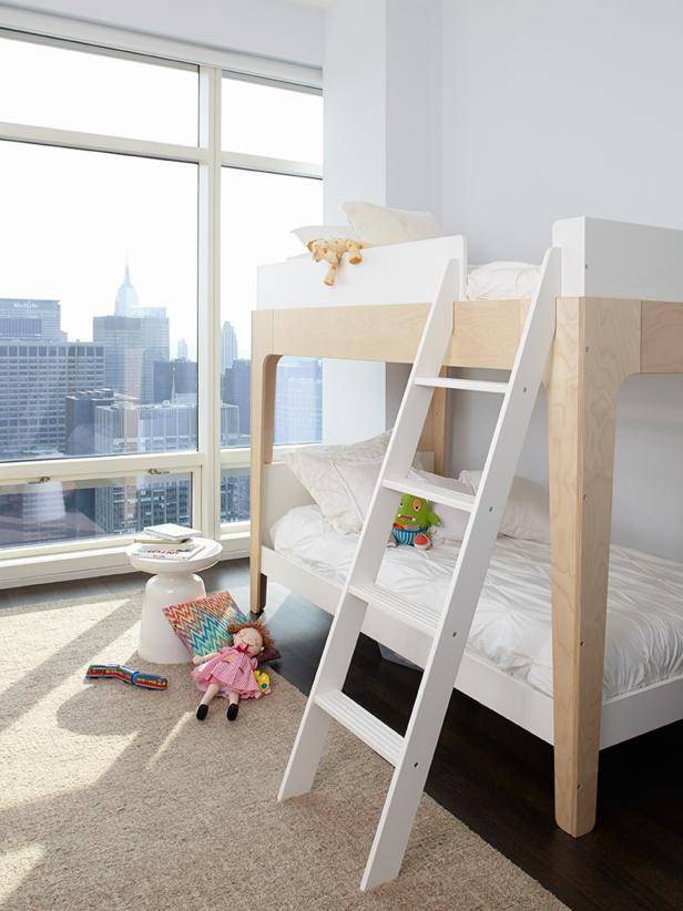 White kids bedroom with bunk beds.