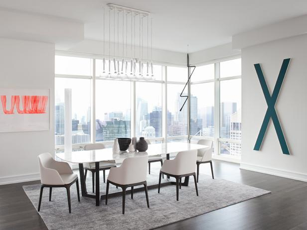White Dining Room With Floor-to-Ceiling Windows and Modern Artwork