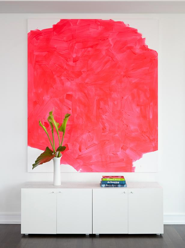 White Living Area With Pink Painting, White Credenza and Green Plant