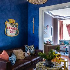 Vibrant Blue Living Room With Sparkly Drum Light