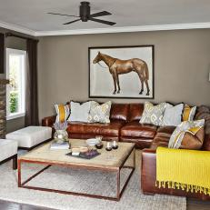 Cozy Living Room With Leather Sectional and Rustic Coffee Table