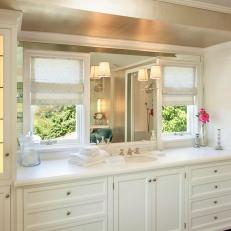 Master Bathroom with Single Vanity and Lighted Storage Cabinets