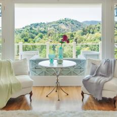 Airy White Sitting Area Offers Breathtaking View