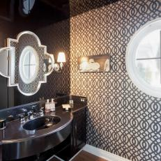 Powder Room With Granite Vanity and Patterned Wallpaper