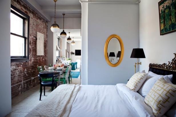 Small White Bedroom Features Gold Mirror, Ornate Headboard