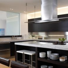 Modern Neutral Kitchen with Black Cabinets and Island