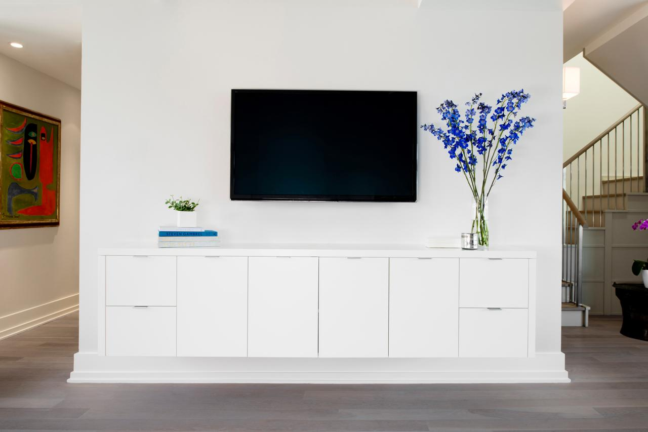 Chic White Modern Media Wall With Built-In Cabinet | HGTV