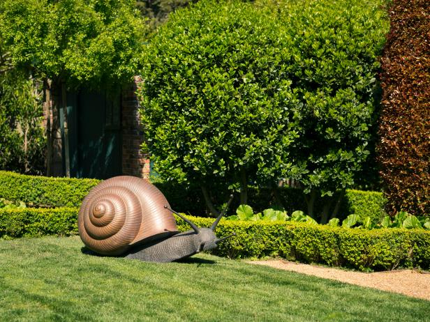 Huge Maetal and Stone Snail Sculpture in Eclectic Garden