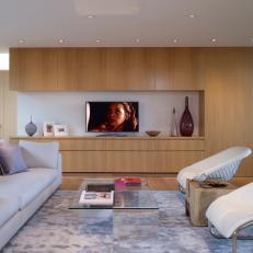 Open and Airy Modern Family Room With Oak Wood Media Wall