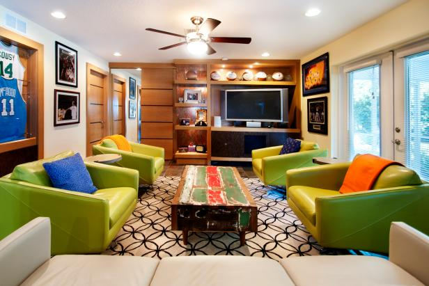 Eclectic Family Room With Sports Memorabilia and Green Chairs