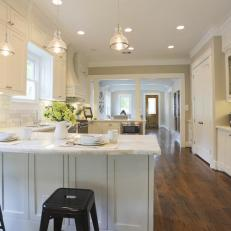 Breakfast Bar In Gray Cottage Kitchen With White Cabinets
