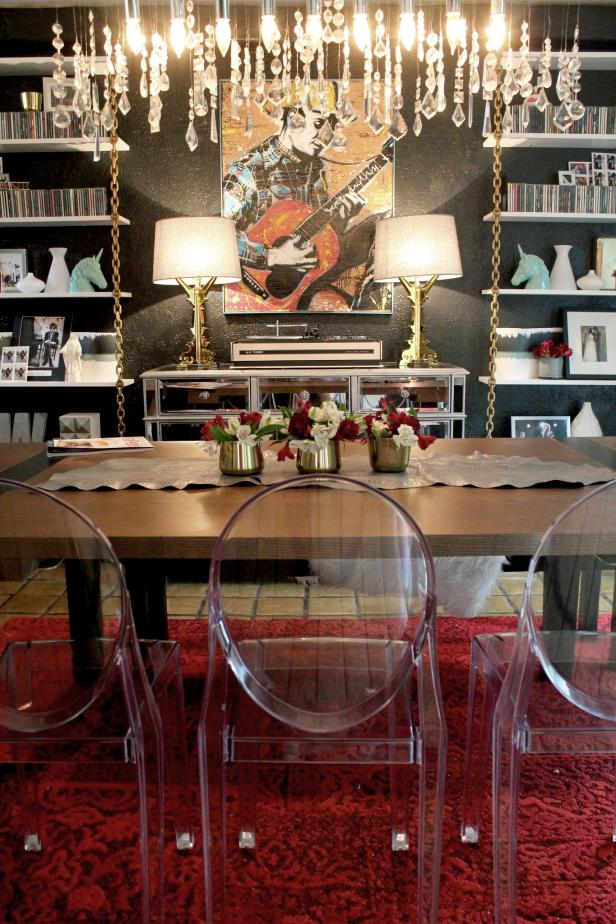 Eclectic Dining Room With Clear Dining Chairs and Crystal Chandelier