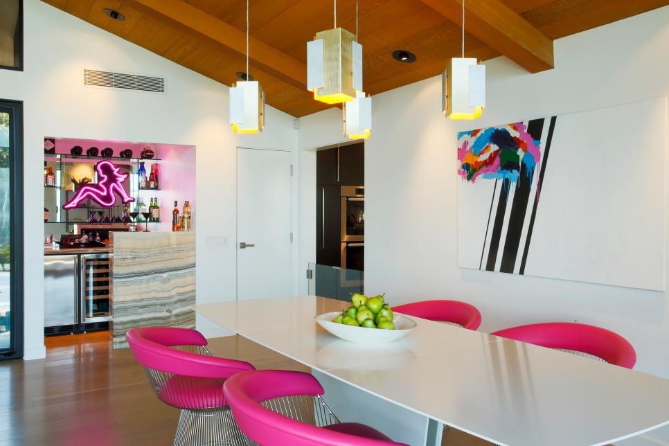 Modern White Dining Room With Pendant Lights and Pink Chairs