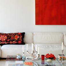 Modern Living Room With Bright Red Wall Art
