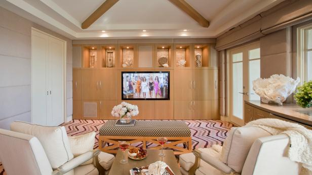 Media Room With Light Wood Cabinets, Chevron Carpet & Cream Chairs