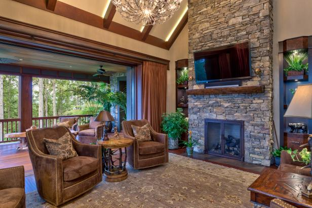 Open-Air Living Room With Stone Fireplace, Access to Balcony