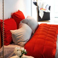 Red and Gray Bed Linens With Floor Lamps in White Bedroom