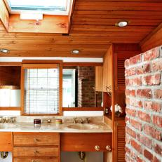 Bathroom with Wood Plank Ceiling and Exposed Brick