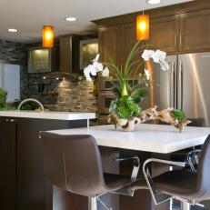 Bon Contemporary Dining Area With Leather Barstools U0026 Orchid Centerpiece. An  Espresso Stained Kitchen Island ...