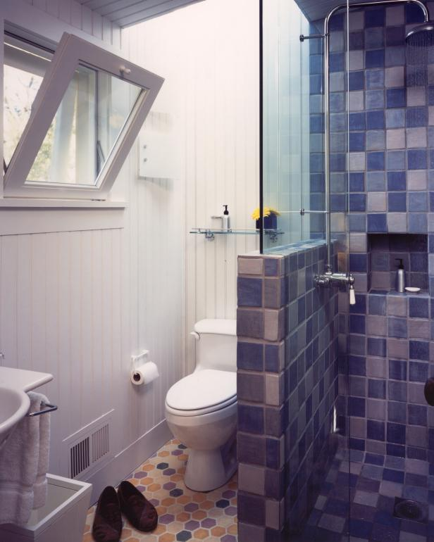 White Bathroom With Yellow Hexagonal Floor Tile and Blue Shower Tile