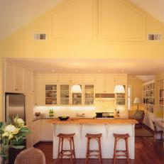 Pale Yellow Cottage-Style Kitchen With Vaulted Ceiling