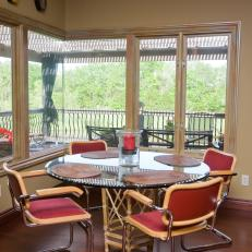 Transitional Dining Area With Wrap-Around Window