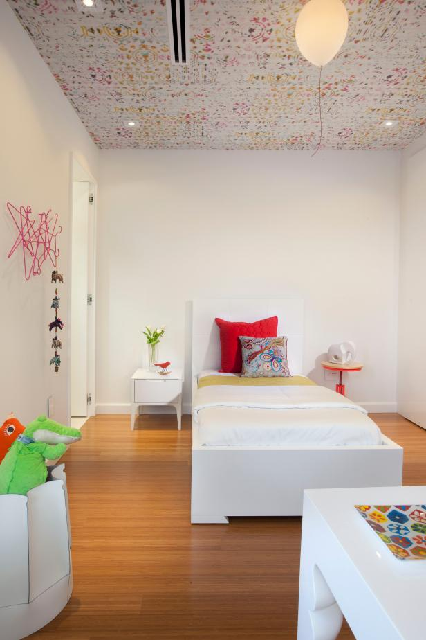 Whimsical accents in a white, modern kids bedroom