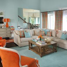 Coastal Aqua Living Room With Bold Orange Accents