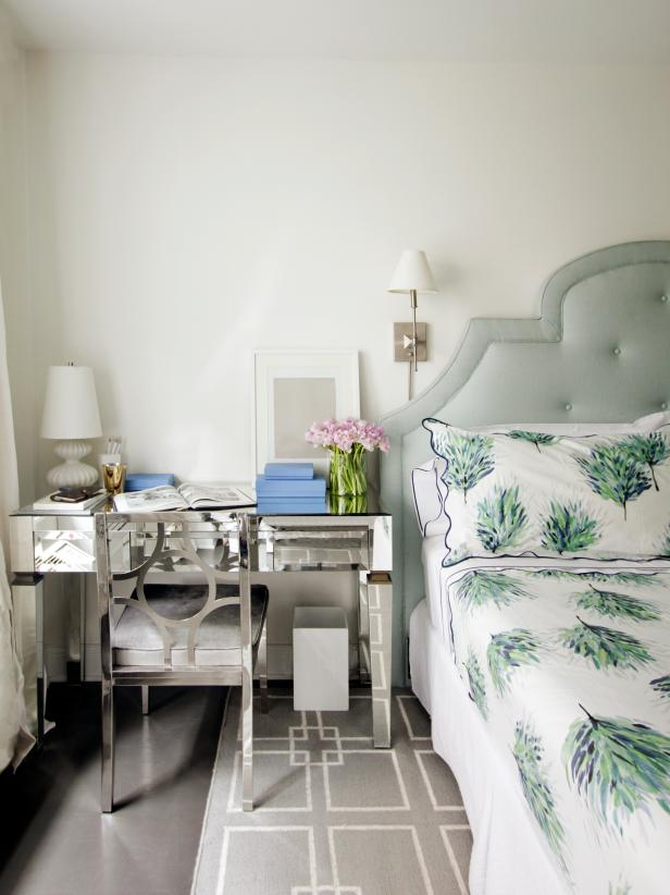 Transitional White Bedroom With Green Headboard and Mirrored Desk