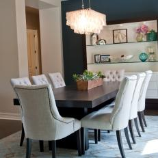 Blue Transitional Dining Room With Eye-Catching Chandelier