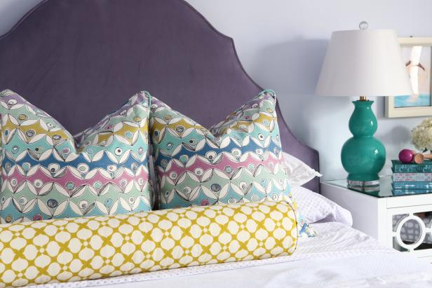 Lavender Kids' Bedroom With Plum Headboard and Mix of Patterns