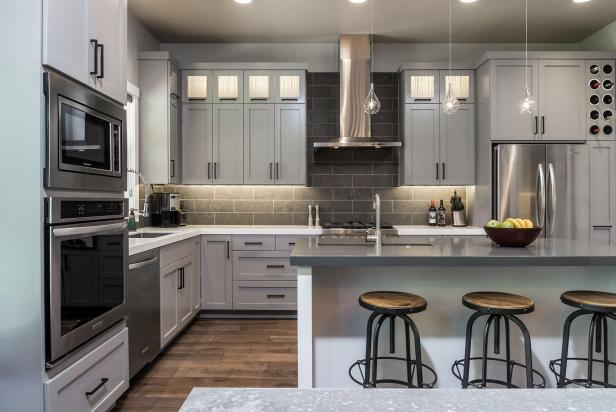 Contemporary Gray Kitchen With Light Gray Cabinets and White Island