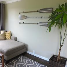 Antique Wooden Oars Used as Art in Neutral Living Space